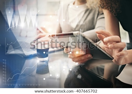 Photo female hands holding modern tablet. Account managers working new investment project in office. Using electronic devices. Graphics icons, worldwide stock exchanges interface. Horizontal - stock photo