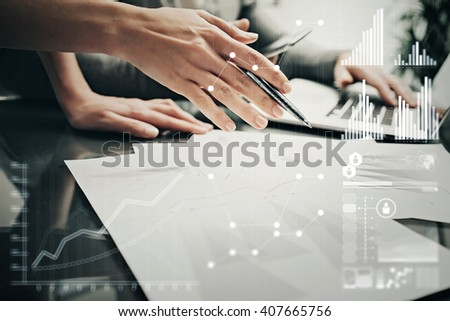 Photo female hands with pen.Businessmans crew working investment project modern office.Using contemporary laptop. Worldwide connection technology icons,stock exchanges graphics interface.  - stock photo