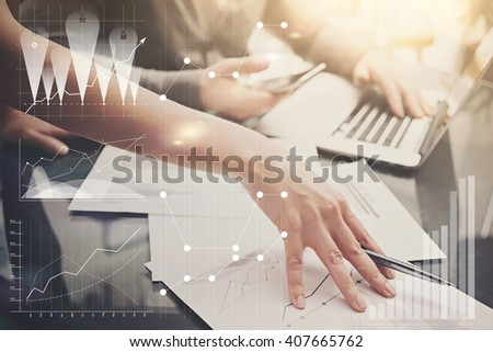 Photo female hands with pen.Businessmans team working investment project modern office.Using contemporary laptop. Worldwide connection technology icons,stock exchanges graphics interface.  - stock photo