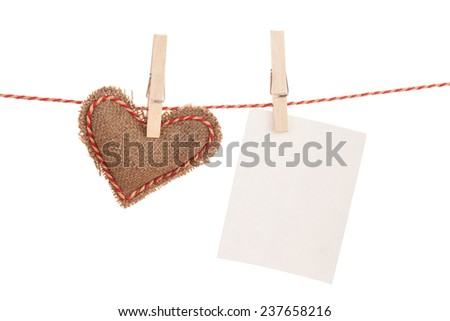 Photo frame and valentines day toy heart hanging on rope. Isolated on white background - stock photo