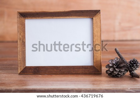 Photo frame in memory on vintage wood - stock photo