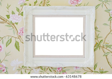 Photo frame on beautiful wallpaper backdrop - stock photo