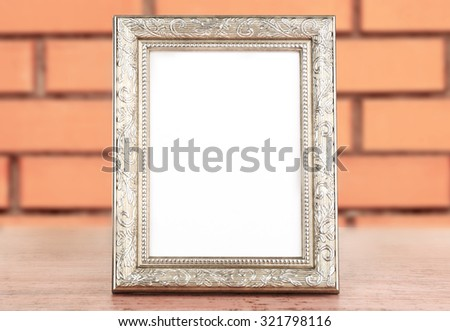Photo frame on brick wall background - stock photo