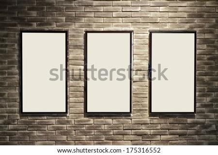 photo frame on old grunge brick wall texture - stock photo