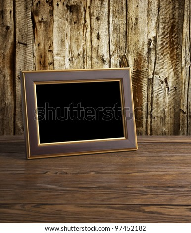 photo frame on old wooden table - stock photo