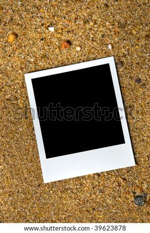 Photo frame on sand background - stock photo