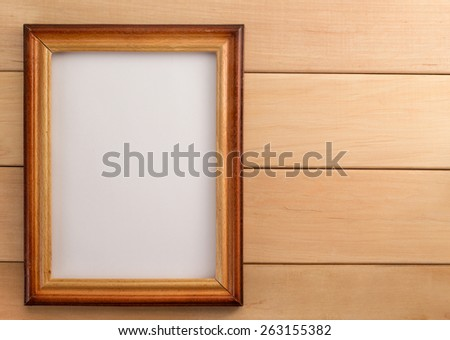 photo frame on wooden background - stock photo
