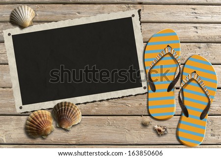 Photo Frame on Wooden Boardwalk with Sand / Aged photo frame with seashells on beach, flip flops sandals on wooden floor with sand - stock photo