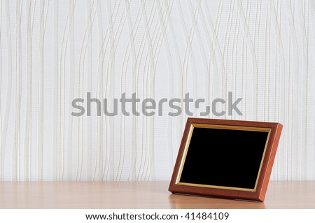 photo frame on wooden table - stock photo