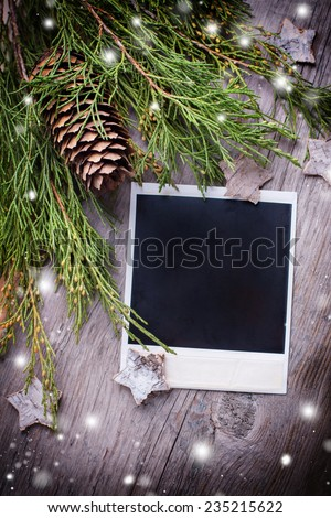 Photo frame, spruce branches and  stars on  wooden background. Christmas background. Selective focus.  - stock photo