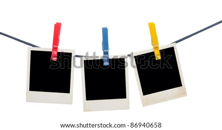 photo frames on a rope isolated on white - stock photo