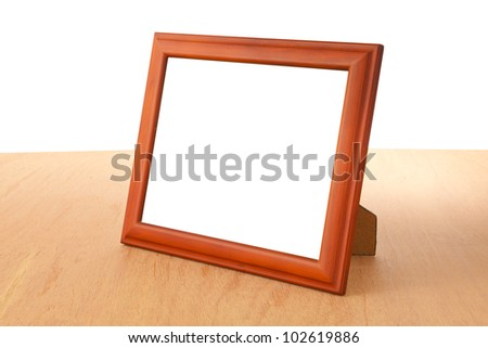 Photo frames on the table and white background - stock photo