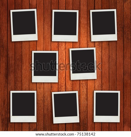 Photo frames on timber wall - stock photo
