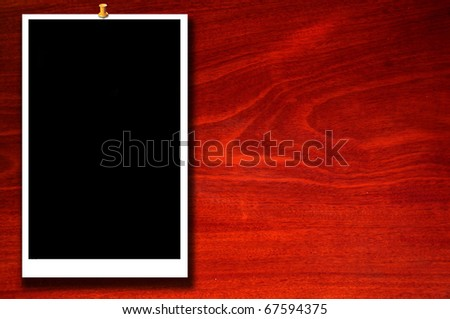 Photo framework on wood texture background  Page decoration. - stock photo