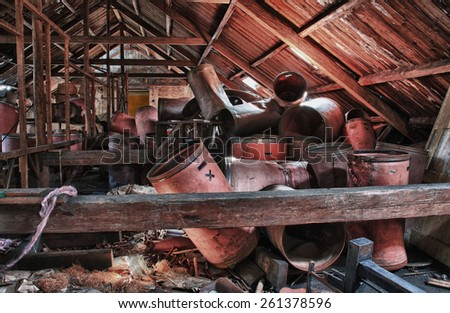 Photo from demolition  textile  factory,barrels under roof. - stock photo