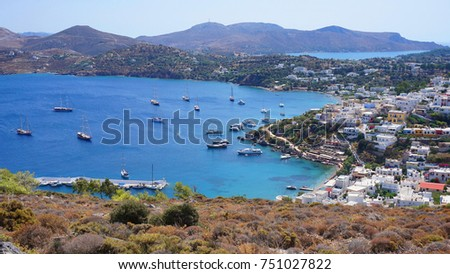 Photo from famous seaside village of Panteli with views to windmills and castle uphill, Leros island, Dodecanese, Greece