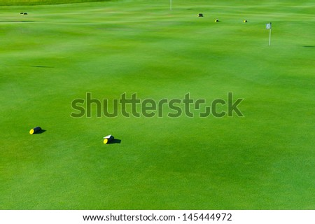 photo golf courses with bright green grass - stock photo