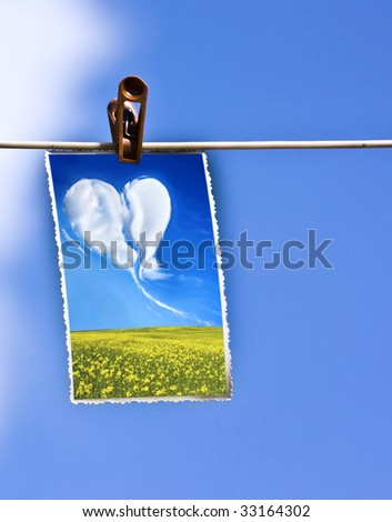 Photo hanging on a clothesline - stock photo