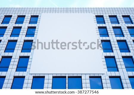 Photo large blank billboard, display on modern skyscraper in center big city for advertising. Horizontal mockup. 3d render - stock photo