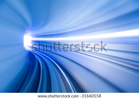 Photo looking in front of an airport train inside tunnel. - stock photo