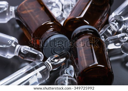Photo medical ampoules on a black background - stock photo