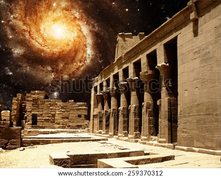 Photo-montage of colonnade entrance to the Temple of Isis at Philae island and Pinwheel Galaxy M101 (Elements of this image furnished by NASA) - stock photo