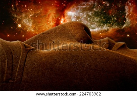 Photo-montage of Ramses II colossus face and the Star forming region S106 (Elements of this image furnished by NASA) - stock photo