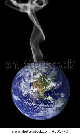 Photo montage representing global warming with smoke rising from the earth.