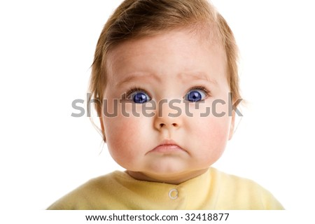 Photo of a baby, staring at camera, isolated on white - stock photo
