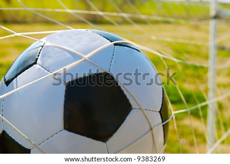 Photo of a ball inside the goal - stock photo