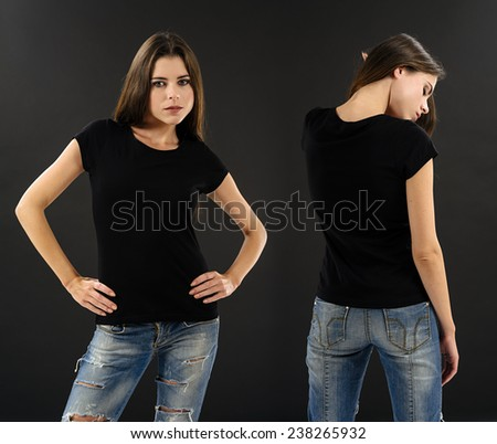 Photo of a beautiful brunette woman with blank black shirt over black background. Ready for your design or artwork. - stock photo