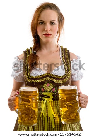 Photo of a beautiful female waitress wearing traditional dirndl and holding huge beers over white background. - stock photo