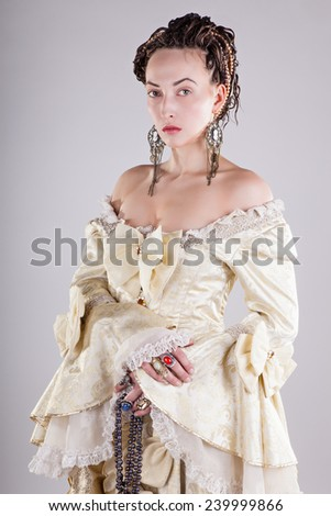 Photo of a beautiful girl in the image of the Empress - stock photo
