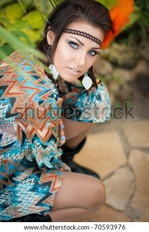 Photo of a brunette posing in the forest - stock photo