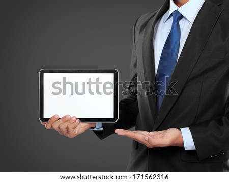photo of a businessman showing blank tablet PC monitor. ready for your design - stock photo