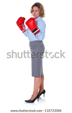 Photo of a businesswoman wearing boxing gloves, isolated on a white background. - stock photo
