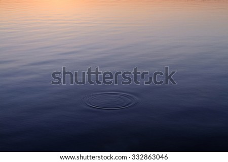 Photo of a calm lake in dusk  - stock photo