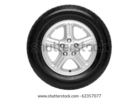 Photo of a car tyre (tire) on a five spoke alloy wheel isolated on a white background with clipping path. - stock photo