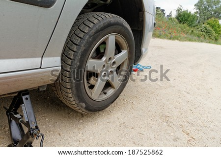 Photo of a car wheel replacement on the road
