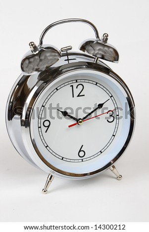 Photo of a chrome analog alarm clock