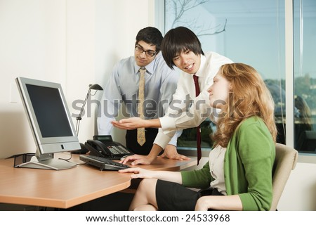 Photo of a consultant explaining the contents of an LCD computer screen. - stock photo