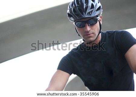 Photo Of A Cyclist Man With Sunglasses And Helmet - stock photo