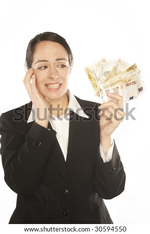 Photo of a depressed young business woman holding currency notes