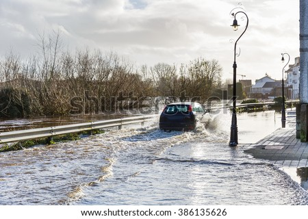 Photo of a flooding river in an irish town - stock photo