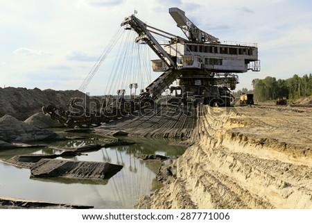 Photo of a giant quarry excavator. - stock photo