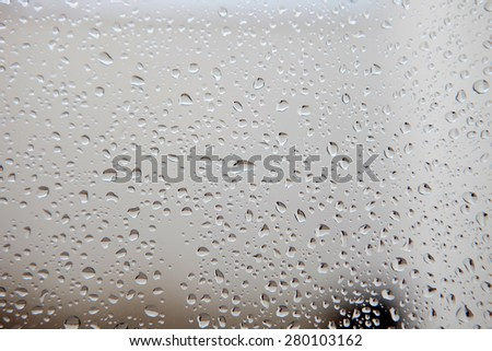 Photo of a glass full of water drops from rain - stock photo