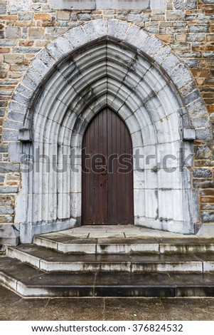 Photo of a gothic arched church door - stock photo