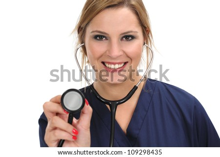 Photo of a happy smiling female doctor or nurse holding a stethoscope.
