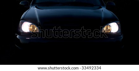 Photo of a headlight of the car - stock photo