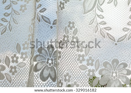 Photo of a lace curtains in the window - stock photo